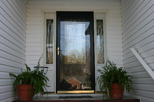 This home has a beautiful front door. It has ornate beveled glass in both